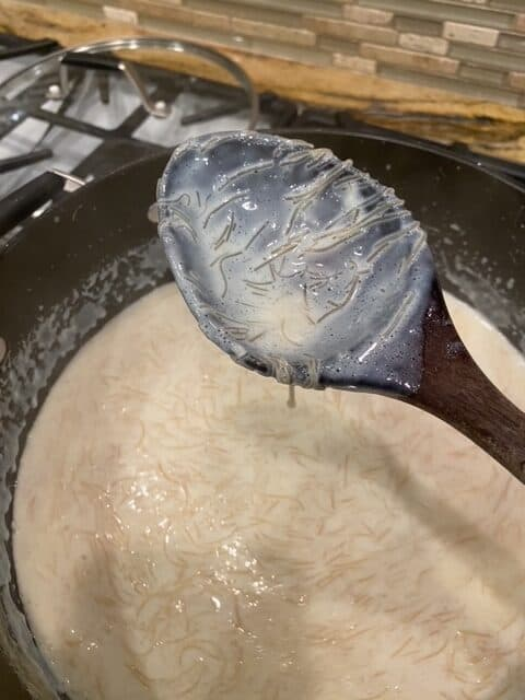 thick enough to coat the spoon